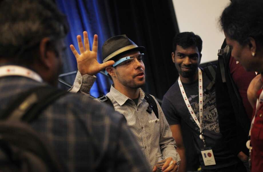 Timothy Jordan (center), senior developer advocate at Google for Project Glass, speaks to Developing for Glass session attendees during Google I/O 2013 at Moscone West on Thursday, May 16, 2013 in San Francisco, Calif.