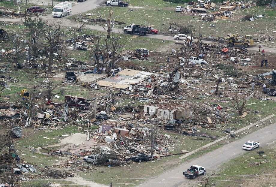 Destroyed homes  are seen in Granbury, Texas on Thursday May 16, 2013.  Ten tornadoes touched down in several small communities in North Texas overnight, leaving at least six people dead, dozens injured and hundreds homeless. (AP Photo/The Fort Worth Star-Telegram,Ron T. Ennis ) Photo: AP