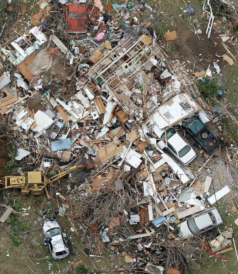 A destroyed home in Granbury, Texas is seen in an aerial view on Thursday May 16, 2013.  Multiple tornados hit the area last night. Ten tornadoes touched down in several small communities in North Texas overnight, leaving at least six people dead, dozens injured and hundreds homeless.    (AP Photo/The Fort Worth Star-Telegram, Ron T. Ennis) Photo: AP