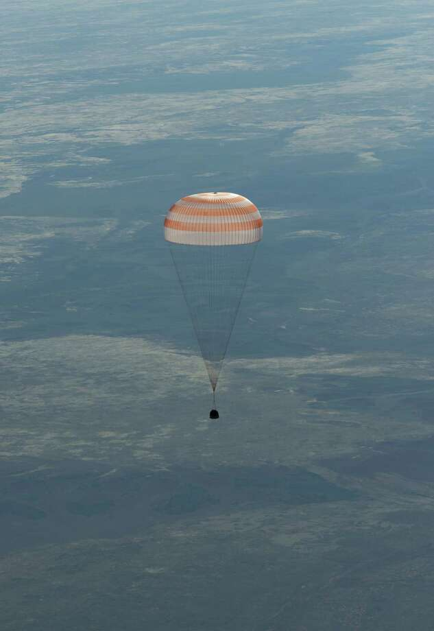 In this image provided by NASA the Soyuz spacecraft is seen as it lands with Expedition 35 Commander Chris Hadfield of the Canadian Space Agency, NASA Flight Engineer Tom Marshburn and Russian Flight Engineer Roman Romanenko of the Russian Federal Space Agency in a remote area near the town of Zhezkazgan, Kazakhstan, on Tuesday, May 14, 2013.  Hadfield, Marshburn and Romanenko returned from five months onboard the International Space Station where they served as members of the Expedition 34 and 35 crews. Photo: AP