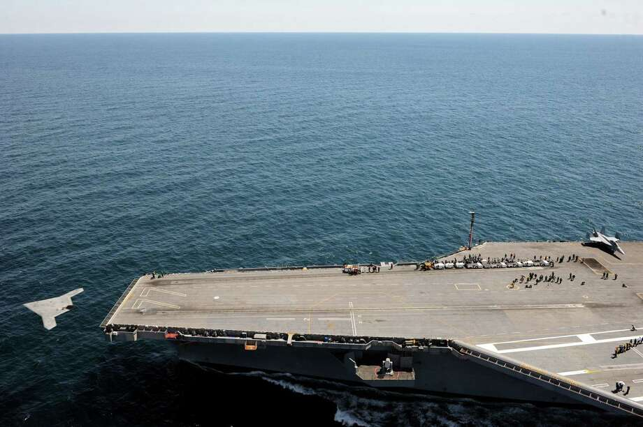 This image provided by the US Navy shows the launch of  an X-47B Unmanned Combat Air System from the flight deck of the aircraft carrier USS George H.W. Bush offf the coast of Virginia Tuesday May 14, 2013. George H.W. Bush is the first aircraft carrier to successfully catapult launch an unmanned aircraft from its flight deck. Photo: AP
