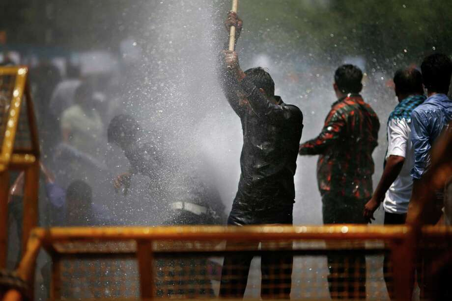 Supporters of Hindu nationalist and main opposition Bharatiya Janata Party (BJP) stage a protest rally against water scarcity in the city as police use water cannon to disperse them, in New Delhi, India, Friday, May 17, 2013. Photo: AP