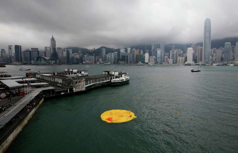 A deflated Rubber Duck created by Dutch artist Florentijn Hofman floats on the water at Hong Kong Victoria Harbor Wednesday, May 15, 2013. The 16.5-meter (54-foot)-tall inflatable Rubber Duck which attracted visitors to the harbor, has been deflated since Tuesday evening. Photo: AP