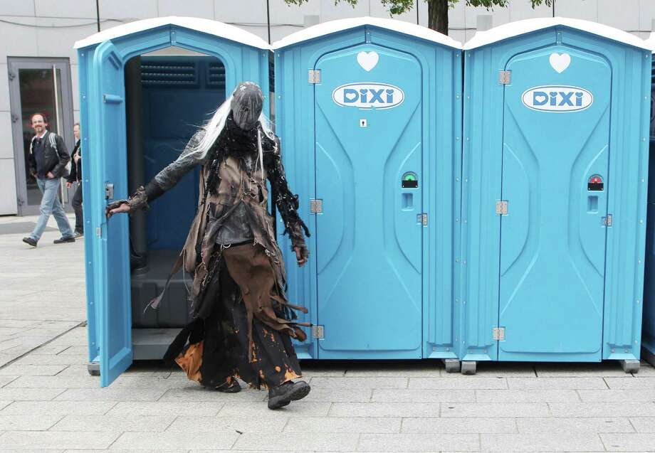"A participant of a Wave-Gothic meeting leaves a port-a-potty on May 19, 2013 in Leipzig, eastern Germany. Organisers expect some 20,000 visitors from all over the world for the ""dark"" music and arts festival running until May 20, 2013. Photo: Getty Images"