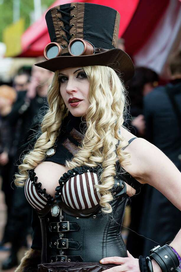 A woman in a steam punk outfit attends the second day of the annual Wave-Gotik Treffen, or Wave and Goth Festival, on May 18, 2013 in Leipzig, Germany. The four-day festival, in which elaborate fashion is a must, brings together over 20,000 Wave, Goth and steam punk enthusiasts from all over the world for concerts, readings, films, a Middle Ages market and workshops. Photo: Marco Prosch, Getty Images / 2013 Marco Prosch