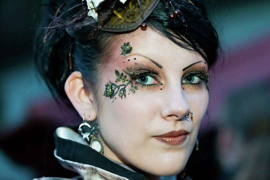 A girl wears flower make-up on the second day of the annual Wave-Gotik Treffen, or Wave and Goth Festival, on May 18, 2013 in Leipzig, Germany. The four-day festival, in which elaborate fashion is a must, brings together over 20,000 Wave, Goth and steam punk enthusiasts from all over the world for concerts, readings, films, a Middle Ages market and workshops. Photo: Marco Prosch, Getty Images / 2013 Marco Prosch