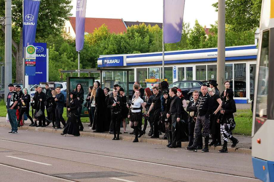 Participants in black clothing wait for the tramway on the second day of the annual Wave-Gotik Treffen, or Wave and Goth Festival, on May 18, 2013 in Leipzig, Germany. The four-day festival, in which elaborate fashion is a must, brings together over 20,000 Wave, Goth and steam punk enthusiasts from all over the world for concerts, readings, films, a Middle Ages market and workshops. Photo: Marco Prosch, Getty Images / 2013 Marco Prosch