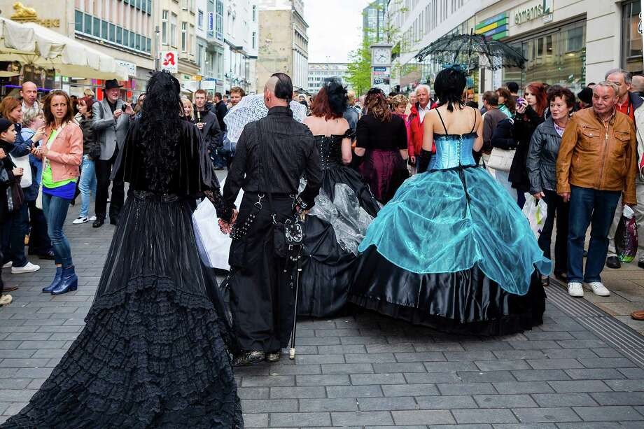 Participants walk through the city in costumes on the second day of the annual Wave-Gotik Treffen, or Wave and Goth Festival, on May 18, 2013 in Leipzig, Germany. The four-day festival, in which elaborate fashion is a must, brings together over 20,000 Wave, Goth and steam punk enthusiasts from all over the world for concerts, readings, films, a Middle Ages market and workshops. Photo: Marco Prosch, Getty Images / 2013 Marco Prosch