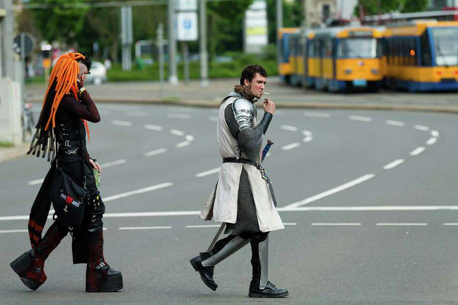 Two men in costumes cross the street on the second day of the annual Wave-Gotik Treffen, or Wave and Goth Festival, on May 18, 2013 in Leipzig, Germany. The four-day festival, in which elaborate fashion is a must, brings together over 20,000 Wave, Goth and steam punk enthusiasts from all over the world for concerts, readings, films, a Middle Ages market and workshops. Photo: Marco Prosch, Getty Images / 2013 Marco Prosch