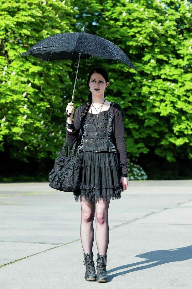 A girl with black clothing and a black umbrella stands on the South Cemetery on the second day of the annual Wave-Gotik Treffen, or Wave and Goth Festival, on May 18, 2013 in Leipzig, Germany. The four-day festival, in which elaborate fashion is a must, brings together over 20,000 Wave, Goth and steam punk enthusiasts from all over the world for concerts, readings, films, a Middle Ages market and workshops. Photo: Marco Prosch, Getty Images / 2013 Marco Prosch