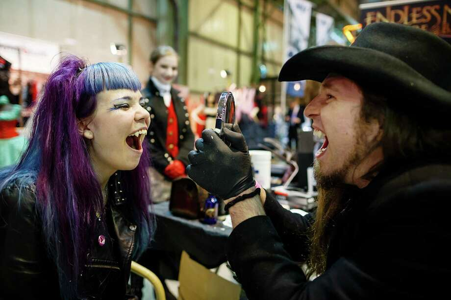 A girl tries out her new fake vampire fangs on the second day of the annual Wave-Gotik Treffen, or Wave and Goth Festival, on May 18, 2013 in Leipzig, Germany. The four-day festival, in which elaborate fashion is a must, brings together over 20,000 Wave, Goth and steam punk enthusiasts from all over the world for concerts, readings, films, a Middle Ages market and workshops. Photo: Marco Prosch, Getty Images / 2013 Marco Prosch