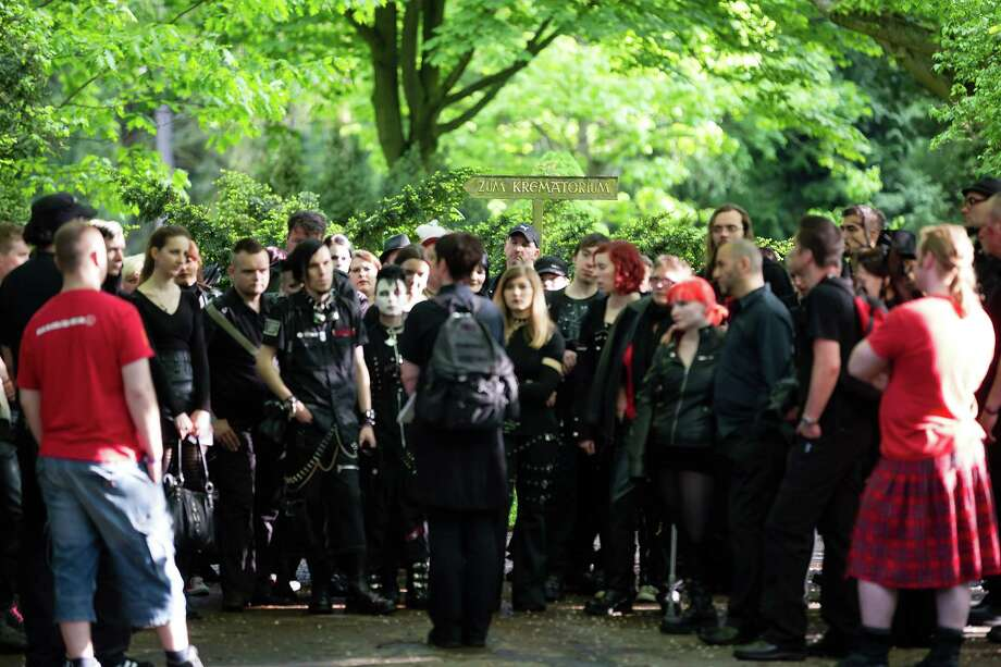 Participants take part in a guided tour of the South Cemetery on the second day of the annual Wave-Gotik Treffen, or Wave and Goth Festival, on May 18, 2013 in Leipzig, Germany. The four-day festival, in which elaborate fashion is a must, brings together over 20,000 Wave, Goth and steam punk enthusiasts from all over the world for concerts, readings, films, a Middle Ages market and workshops. Photo: Marco Prosch, Getty Images / 2013 Marco Prosch