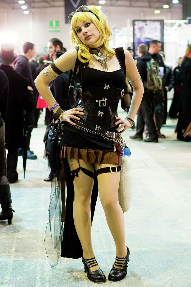 A girl in a steam punk outfit poses for pictures on the second day of the annual Wave-Gotik Treffen, or Wave and Goth Festival, on May 18, 2013 in Leipzig, Germany. The four-day festival, in which elaborate fashion is a must, brings together over 20,000 Wave, Goth and steam punk enthusiasts from all over the world for concerts, readings, films, a Middle Ages market and workshops. Photo: Marco Prosch, Getty Images / 2013 Marco Prosch