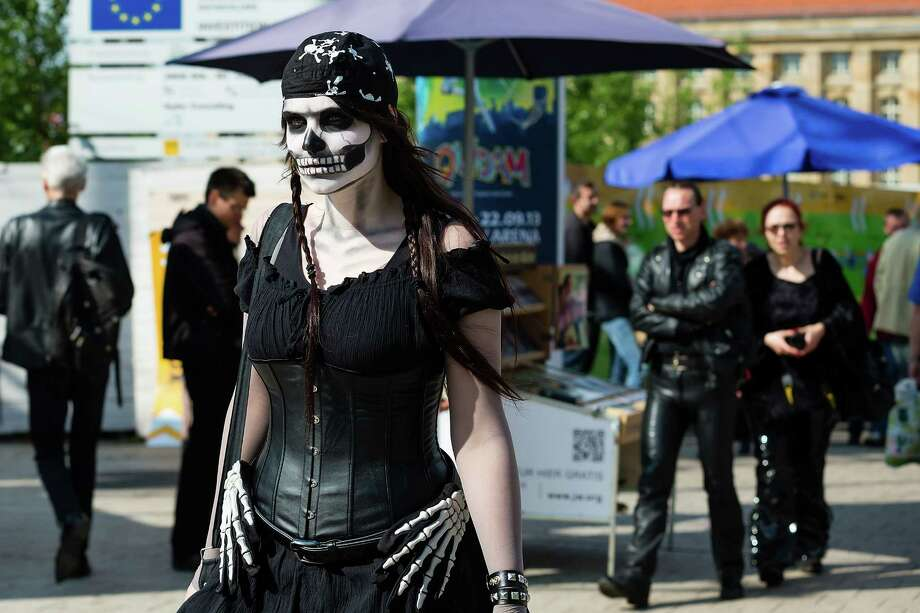 A woman with skull make-up walks on the street on the second day of the annual Wave-Gotik Treffen, or Wave and Goth Festival, on May 18, 2013 in Leipzig, Germany. The four-day festival, in which elaborate fashion is a must, brings together over 20,000 Wave, Goth and steam punk enthusiasts from all over the world for concerts, readings, films, a Middle Ages market and workshops. Photo: Marco Prosch, Getty Images / 2013 Marco Prosch