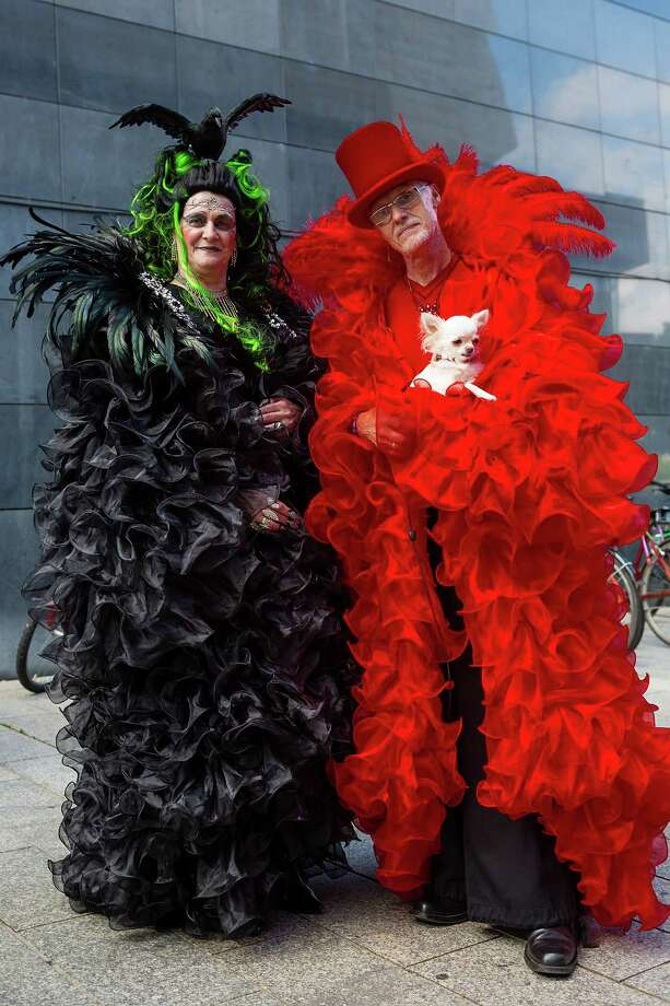 A woman in a black costume with a stuffed crow on her head and a man in a red costume with a live Chihuahua attend the second day of the annual Wave-Gotik Treffen, or Wave and Goth Festival, on May 18, 2013 in Leipzig, Germany. The four-day festival, in which elaborate fashion is a must, brings together over 20,000 Wave, Goth and steam punk enthusiasts from all over the world for concerts, readings, films, a Middle Ages market and workshops. Photo: Marco Prosch, Getty Images / 2013 Marco Prosch