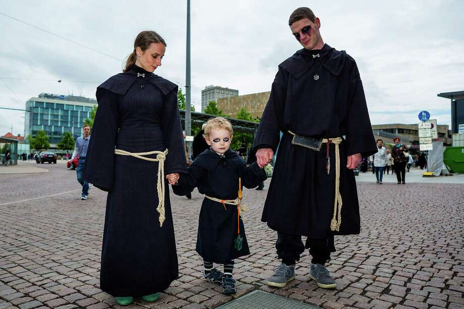A young family dressed in black attends the second day of the annual Wave-Gotik Treffen, or Wave and Goth Festival, on May 18, 2013 in Leipzig, Germany. The four-day festival, in which elaborate fashion is a must, brings together over 20,000 Wave, Goth and steam punk enthusiasts from all over the world for concerts, readings, films, a Middle Ages market and workshops. Photo: Marco Prosch, Getty Images / 2013 Marco Prosch