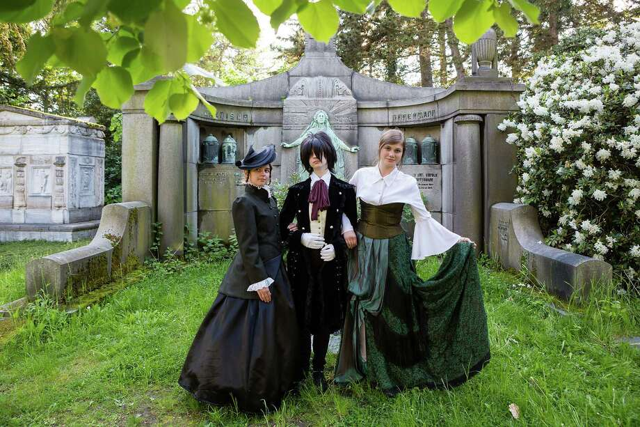Participants in costumes pose for pictures at the South Cemetery on the second day of the annual Wave-Gotik Treffen, or Wave and Goth Festival, on May 18, 2013 in Leipzig, Germany. The four-day festival, in which elaborate fashion is a must, brings together over 20,000 Wave, Goth and steam punk enthusiasts from all over the world for concerts, readings, films, a Middle Ages market and workshops. Photo: Marco Prosch, Getty Images / 2013 Marco Prosch
