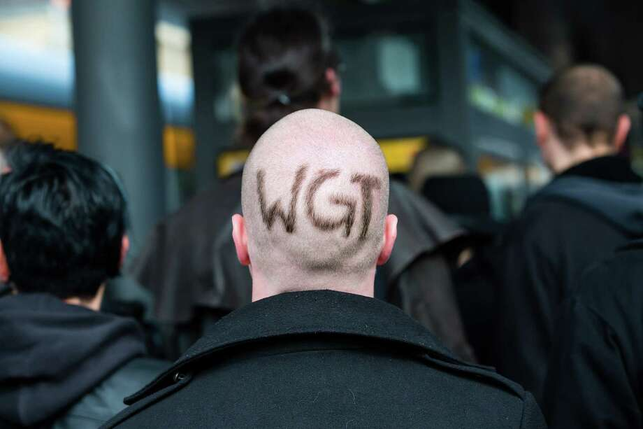 "A man with has the letters 'WGT"" shaved into his hair attends the second day of the annual Wave-Gotik Treffen, or Wave and Goth Festival, on May 18, 2013 in Leipzig, Germany. The four-day festival, in which elaborate fashion is a must, brings together over 20,000 Wave, Goth and steam punk enthusiasts from all over the world for concerts, readings, films, a Middle Ages market and workshops. Photo: Marco Prosch, Getty Images / 2013 Marco Prosch"