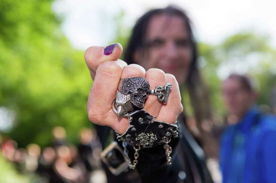 A man shows his ring with a skull ornament on the second day of the annual Wave-Gotik Treffen, or Wave and Goth Festival, on May 18, 2013 in Leipzig, Germany. The four-day festival, in which elaborate fashion is a must, brings together over 20,000 Wave, Goth and steam punk enthusiasts from all over the world for concerts, readings, films, a Middle Ages market and workshops. Photo: Marco Prosch, Getty Images / 2013 Marco Prosch