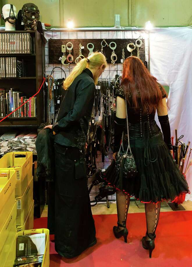 A couple looks at handcuffs and whips for sale at the Agra festival area on the first day of the annual Wave-Gotik Treffen, or Wave and Goth Festival, on May 17, 2013 in Leipzig, Germany. The four-day festival, in which elaborate fashion is a must, brings together over 20,000 Wave, Goth and steam punk enthusiasts from all over the world for concerts, readings, films, a Middle Ages market and workshops. Photo: Marco Prosch, Getty Images / 2013 Getty Images