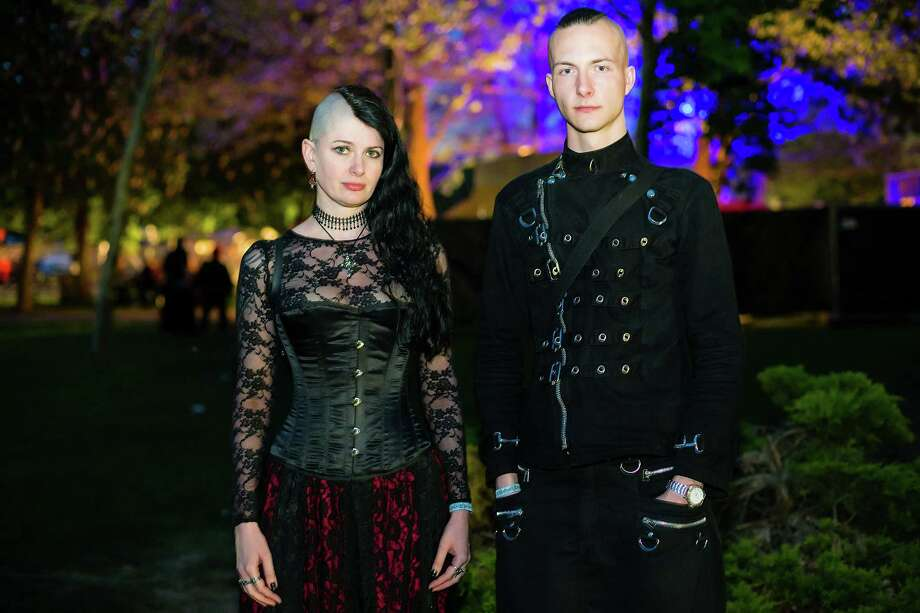 A goth couple poses for pictures at the Agra festival area on the first day of the annual Wave-Gotik Treffen, or Wave and Goth Festival, on May 17, 2013 in Leipzig, Germany. The four-day festival, in which elaborate fashion is a must, brings together over 20,000 Wave, Goth and steam punk enthusiasts from all over the world for concerts, readings, films, a Middle Ages market and workshops. Photo: Marco Prosch, Getty Images / 2013 Getty Images