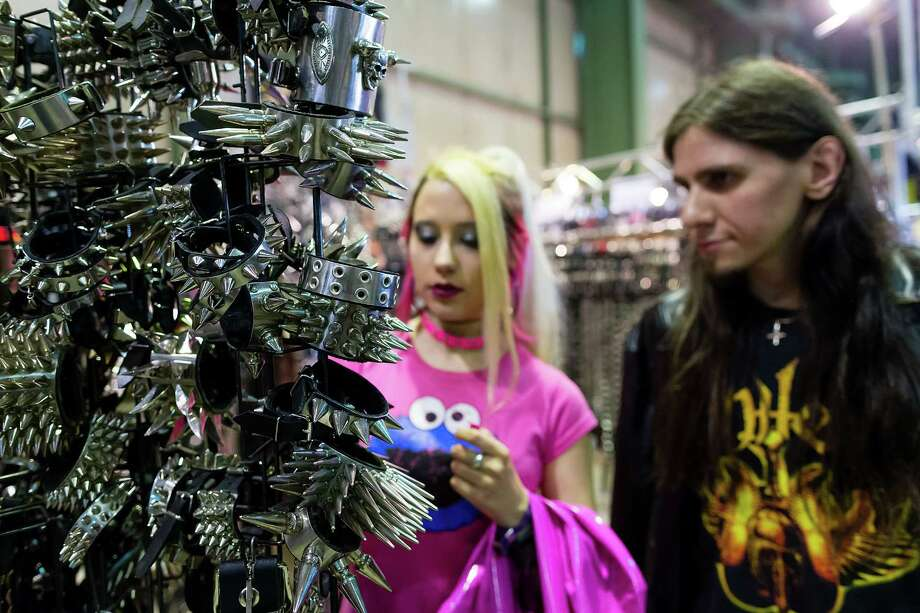 A couple looks at metal thorn collars which are for sale at the Agra festival area on the first day of the annual Wave-Gotik Treffen, or Wave and Goth Festival, on May 17, 2013 in Leipzig, Germany. The four-day festival, in which elaborate fashion is a must, brings together over 20,000 Wave, Goth and steam punk enthusiasts from all over the world for concerts, readings, films, a Middle Ages market and workshops. Photo: Marco Prosch, Getty Images / 2013 Getty Images