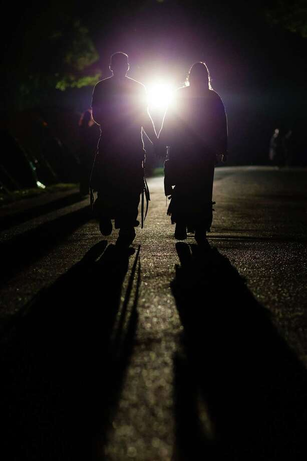 A goth couple walks towards a light at the camping site at the Agra festival area on the first day of the annual Wave-Gotik Treffen, or Wave and Goth Festival, on May 17, 2013 in Leipzig, Germany. The four-day festival, in which elaborate fashion is a must, brings together over 20,000 Wave, Goth and steam punk enthusiasts from all over the world for concerts, readings, films, a Middle Ages market and workshops. Photo: Marco Prosch, Getty Images / 2013 Getty Images