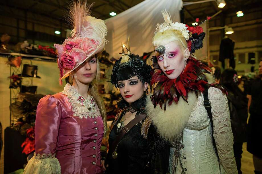 Three girls in Victorian clothing pose for pictures at the Agra festival area on the first day of the annual Wave-Gotik Treffen, or Wave and Goth Festival, on May 17, 2013 in Leipzig, Germany. The four-day festival, in which elaborate fashion is a must, brings together over 20,000 Wave, Goth and steam punk enthusiasts from all over the world for concerts, readings, films, a Middle Ages market and workshops. Photo: Marco Prosch, Getty Images / 2013 Getty Images