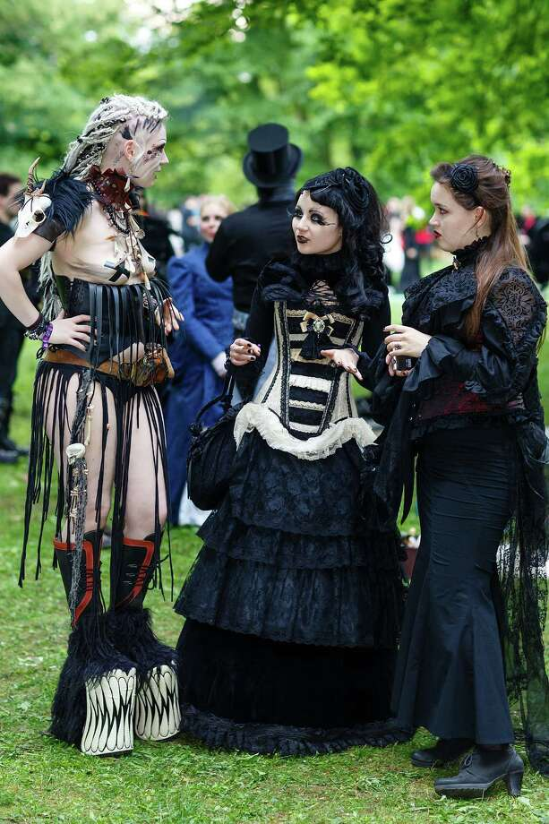 Three women in Victorian-style clothing chat during the traditional park picnic on the first day of the annual Wave-Gotik Treffen, or Wave and Goth Festival, on May 17, 2013 in Leipzig, Germany. The four-day festival, in which elaborate fashion is a must, brings together over 20,000 Wave, Goth and steam punk enthusiasts from all over the world for concerts, readings, films, a Middle Ages market and workshops. Photo: Marco Prosch, Getty Images / 2013 Getty Images
