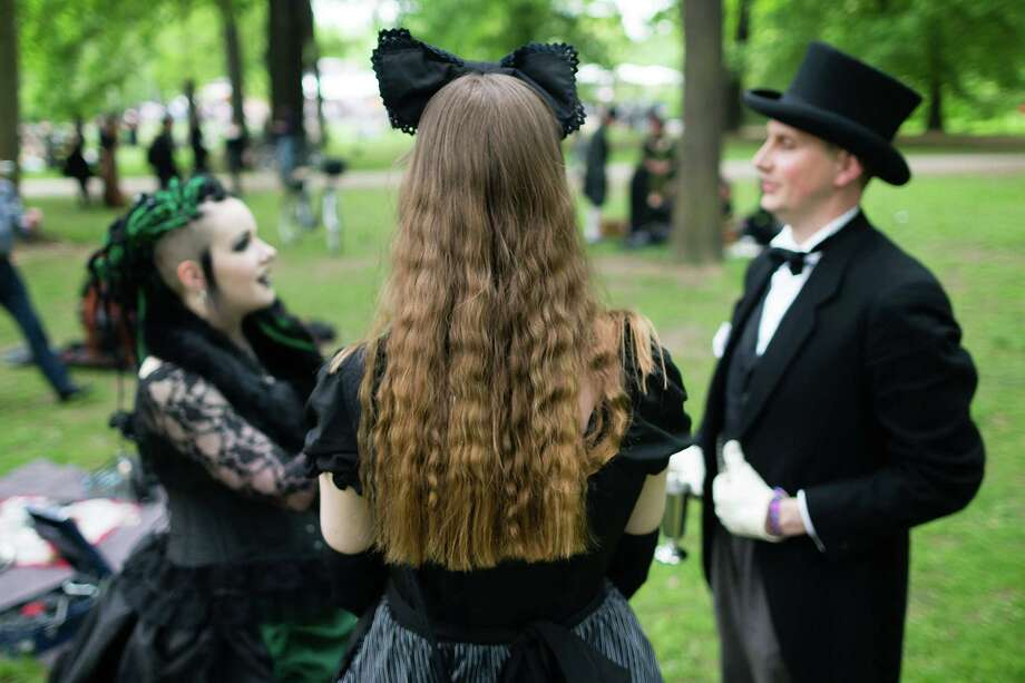 Participants in Victorian clothing chat during the traditional park picnic on the first day of the annual Wave-Gotik Treffen, or Wave and Goth Festival, on May 17, 2013 in Leipzig, Germany. The four-day festival, in which elaborate fashion is a must, brings together over 20,000 Wave, Goth and steam punk enthusiasts from all over the world for concerts, readings, films, a Middle Ages market and workshops. Photo: Marco Prosch, Getty Images / 2013 Getty Images