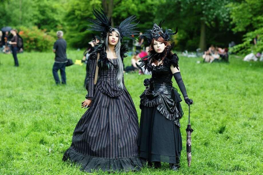 Participants in black clothing and feather-hats pose for pictures during the traditional park picnic on the first day of the annual Wave-Gotik Treffen, or Wave and Goth Festival, on May 17, 2013 in Leipzig, Germany. The four-day festival, in which elaborate fashion is a must, brings together over 20,000 Wave, Goth and steam punk enthusiasts from all over the world for concerts, readings, films, a Middle Ages market and workshops. Photo: Marco Prosch, Getty Images / 2013 Getty Images