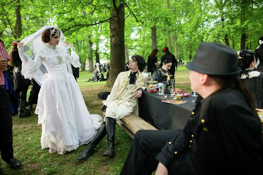Participants in Victorian clothing attend the traditional park picnic on the first day of the annual Wave-Gotik Treffen, or Wave and Goth Festival, on May 17, 2013 in Leipzig, Germany. The four-day festival, in which elaborate fashion is a must, brings together over 20,000 Wave, Goth and steam punk enthusiasts from all over the world for concerts, readings, films, a Middle Ages market and workshops. Photo: Marco Prosch, Getty Images / 2013 Getty Images