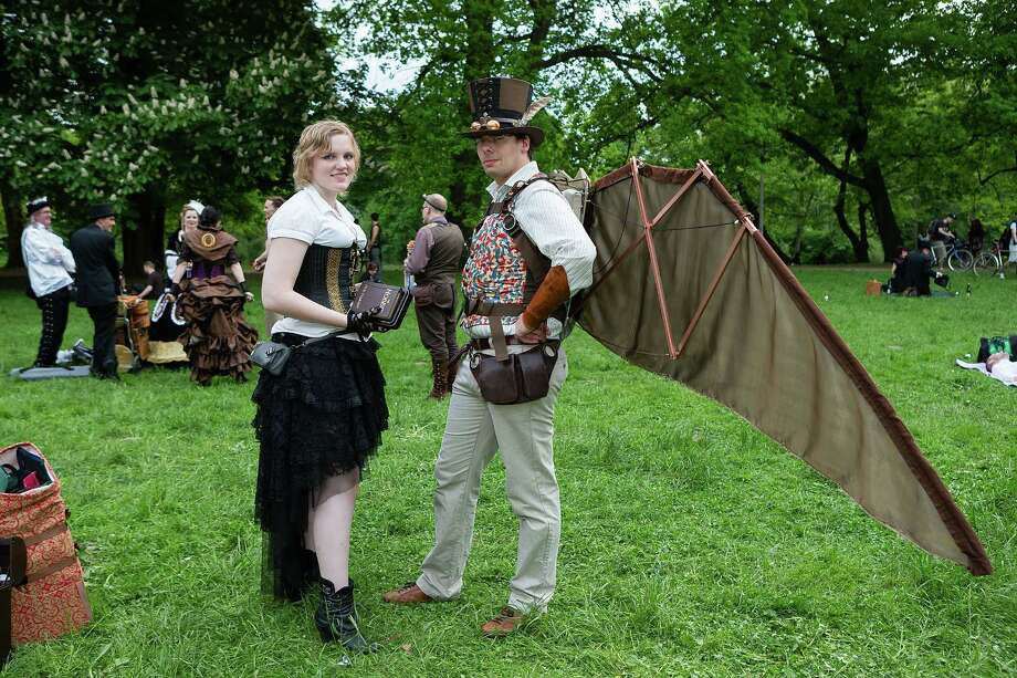 A man in a steam-punk outfit with self-made wings and a woman in Victorian clothing holding the book 'The Hobbit' attend the traditional park picnic on the first day of the annual Wave-Gotik Treffen, or Wave and Goth Festival, on May 17, 2013 in Leipzig, Germany. The four-day festival, in which elaborate fashion is a must, brings together over 20,000 Wave, Goth and steam punk enthusiasts from all over the world for concerts, readings, films, a Middle Ages market and workshops. Photo: Marco Prosch, Getty Images / 2013 Getty Images