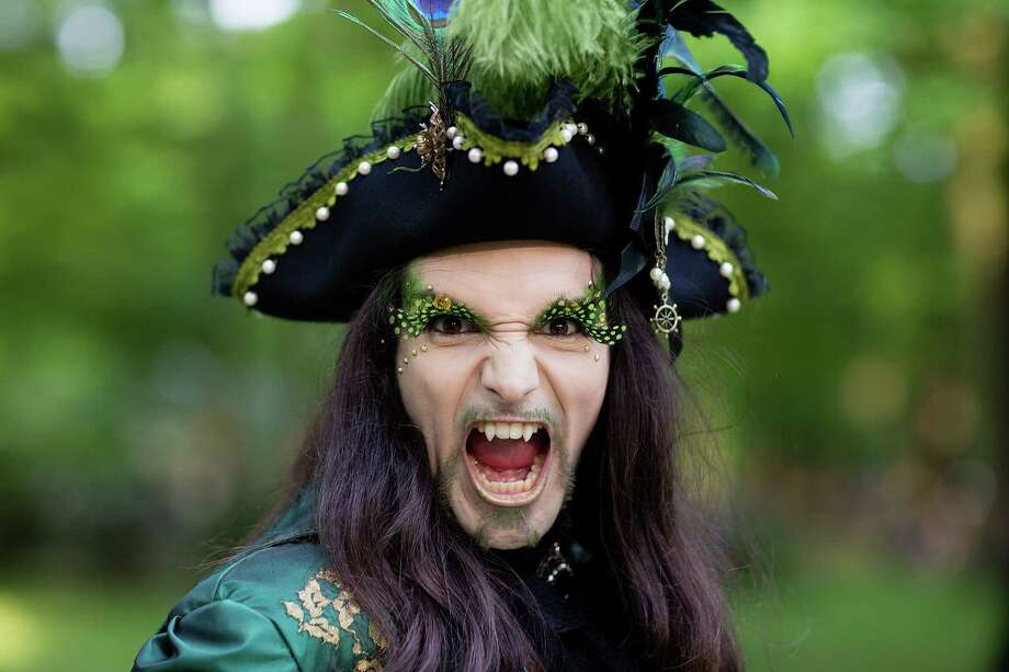 A man with fake vampire teeth wearing a pirate's costume attends the traditional park picnic on the first day of the annual Wave-Gotik Treffen, or Wave and Goth Festival, on May 17, 2013 in Leipzig, Germany. The four-day festival, in which elaborate fashion is a must, brings together over 20,000 Wave, Goth and steam punk enthusiasts from all over the world for concerts, readings, films, a Middle Ages market and workshops. Photo: Marco Prosch, Getty Images / 2013 Getty Images