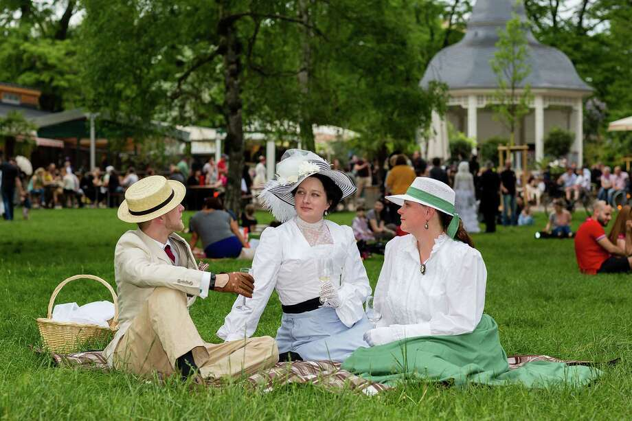 Participants in Victorian clothing sit on the lawn and chat during the traditional park picnic on the first day of the annual Wave-Gotik Treffen, or Wave and Goth Festival, on May 17, 2013 in Leipzig, Germany. The four-day festival, in which elaborate fashion is a must, brings together over 20,000 Wave, Goth and steam punk enthusiasts from all over the world for concerts, readings, films, a Middle Ages market and workshops. Photo: Marco Prosch, Getty Images / 2013 Getty Images