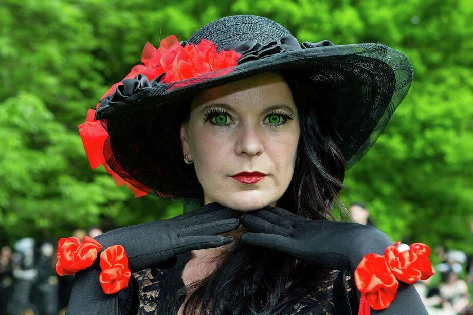 A woman with fake green eyes wearing hat and gloves poses for pictures during the traditional park picnic on the first day of the annual Wave-Gotik Treffen, or Wave and Goth Festival, on May 17, 2013 in Leipzig, Germany. The four-day festival, in which elaborate fashion is a must, brings together over 20,000 Wave, Goth and steam punk enthusiasts from all over the world for concerts, readings, films, a Middle Ages market and workshops. Photo: Marco Prosch, Getty Images / 2013 Getty Images