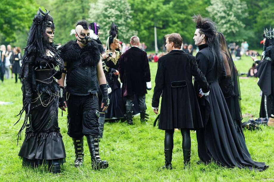 A couple wearing steam-punk costumes meets other participients in Goth clothing during the traditional park picnic on the first day of the annual Wave-Gotik Treffen, or Wave and Goth Festival, on May 17, 2013 in Leipzig, Germany. The four-day festival, in which elaborate fashion is a must, brings together over 20,000 Wave, Goth and steam punk enthusiasts from all over the world for concerts, readings, films, a Middle Ages market and workshops. Photo: Marco Prosch, Getty Images / 2013 Getty Images