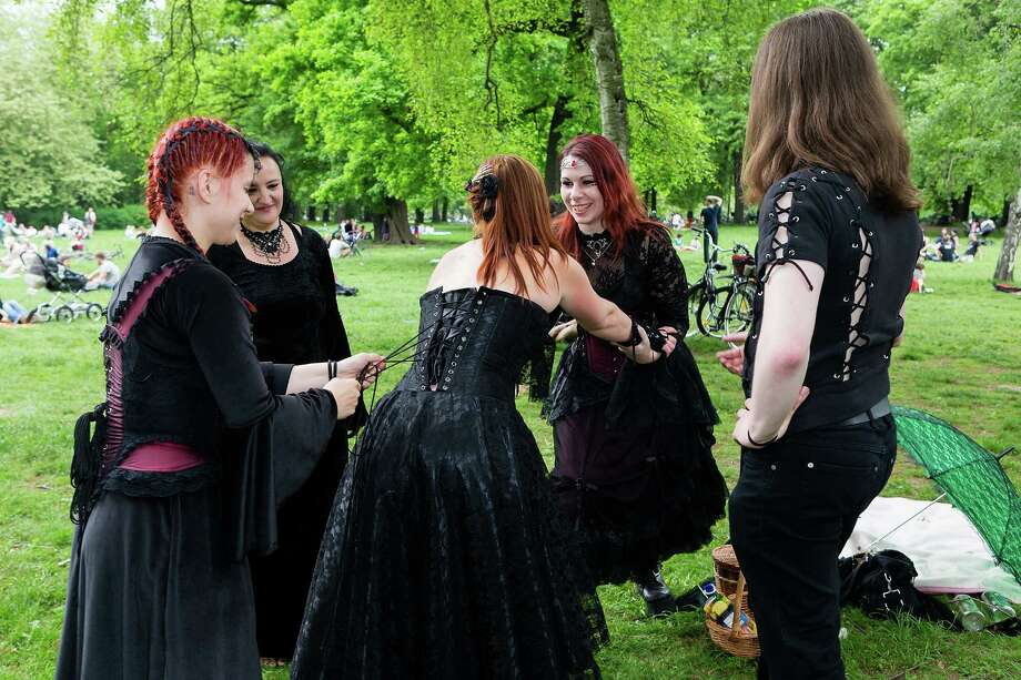 Two women help their friend straightening her corset during the traditional park picnic on the first day of the annual Wave-Gotik Treffen, or Wave and Goth Festival, on May 17, 2013 in Leipzig, Germany. The four-day festival, in which elaborate fashion is a must, brings together over 20,000 Wave, Goth and steam punk enthusiasts from all over the world for concerts, readings, films, a Middle Ages market and workshops. Photo: Marco Prosch, Getty Images / 2013 Getty Images