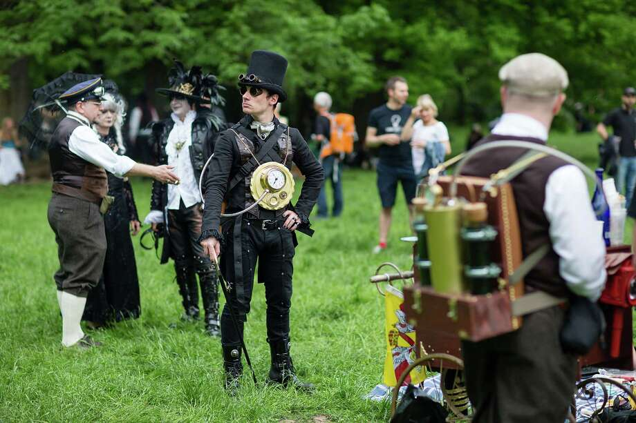 A man dressed in a steam-punk costume attends the traditional park picnic on the first day of the annual Wave-Gotik Treffen, or Wave and Goth Festival, on May 17, 2013 in Leipzig, Germany. The four-day festival, in which elaborate fashion is a must, brings together over 20,000 Wave, Goth and steam punk enthusiasts from all over the world for concerts, readings, films, a Middle Ages market and workshops. Photo: Marco Prosch, Getty Images / 2013 Getty Images