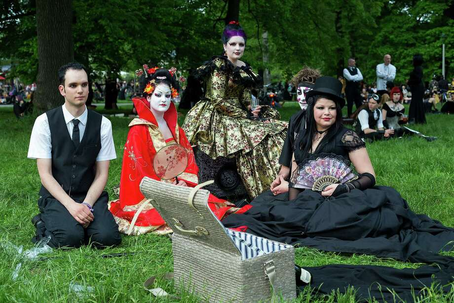 Participants in costumes attend the traditional park picnic on the first day of the annual Wave-Gotik Treffen, or Wave and Goth Festival, on May 17, 2013 in Leipzig, Germany. The four-day festival, in which elaborate fashion is a must, brings together over 20,000 Wave, Goth and steam punk enthusiasts from all over the world for concerts, readings, films, a Middle Ages market and workshops. Photo: Marco Prosch, Getty Images / 2013 Getty Images