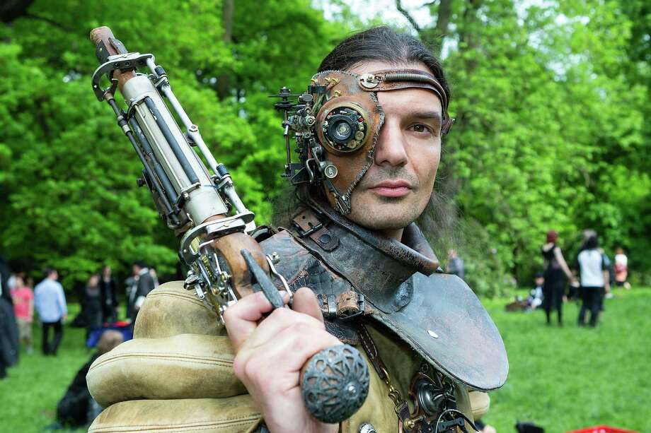 A man dressed as a steam-punk attends the traditional park picnic on the first day of the annual Wave-Gotik Treffen, or Wave and Goth Festival, on May 17, 2013 in Leipzig, Germany. The four-day festival, in which elaborate fashion is a must, brings together over 20,000 Wave, Goth and steam punk enthusiasts from all over the world for concerts, readings, films, a Middle Ages market and workshops. Photo: Marco Prosch, Getty Images / 2013 Getty Images