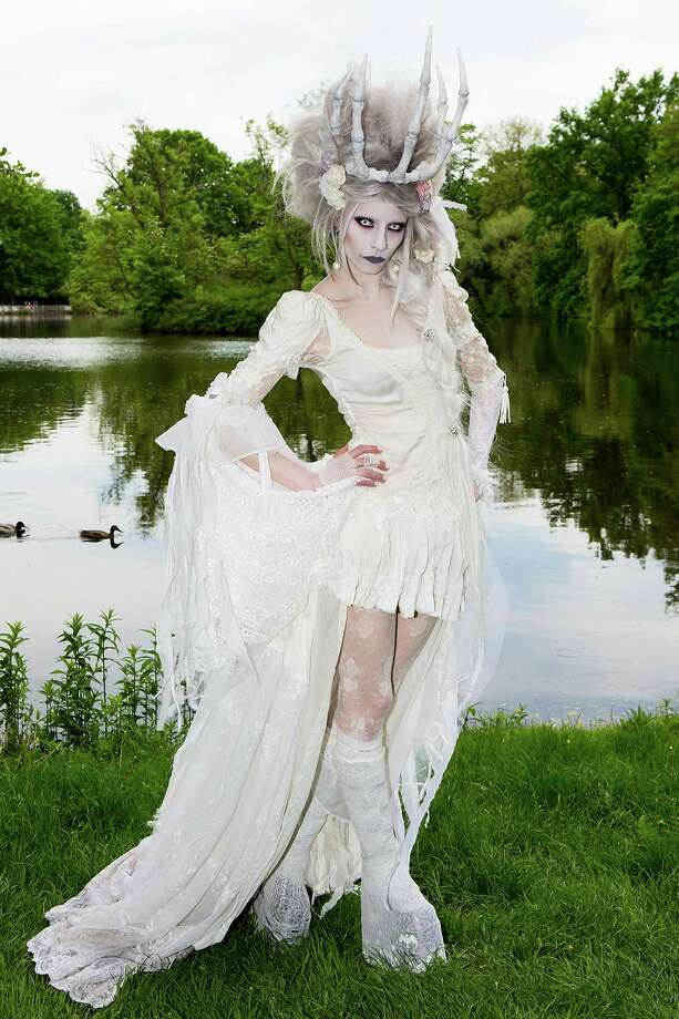 A girl in a vamire costume poses for pictures during the traditional park picnic on the first day of the annual Wave-Gotik Treffen, or Wave and Goth Festival, on May 17, 2013 in Leipzig, Germany. The four-day festival, in which elaborate fashion is a must, brings together over 20,000 Wave, Goth and steam punk enthusiasts from all over the world for concerts, readings, films, a Middle Ages market and workshops. Photo: Marco Prosch, Getty Images / 2013 Getty Images