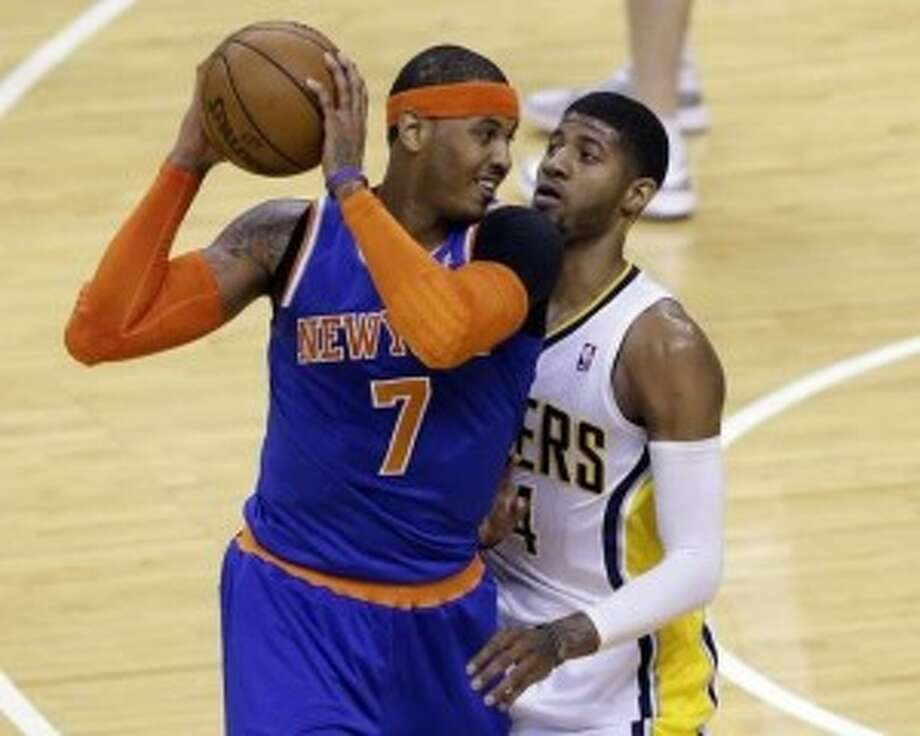Paul George's defense on Carmelo Anthony was crucial to Indiana's series win over the Knicks. The Pacers will need more of the same on LeBron to take down the Heat and advance to the Finals (AP Photo/Michael Conroy).