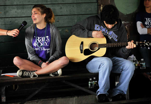 Brittany Duffin, left, sings a song while being backed up on guitar by Colby Rich during the fourth annual Rae's Day suicide prevention rally at Cove Island Park in Stamford on Sunday, May 19, 2013. Rae's Day was held to raise money for the Rachel Sottosanti Memorial Scholarship Fund and to raise awareness for suicide prevention. Sottosanti, a Westhill High School athlete, committed suicide in 2009. Photo: Jason Rearick / Stamford Advocate