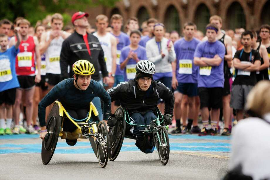 Wheelchair athletes kick off the eight kilometer race at the 31st annual Nordstrom Beat the Bridge event Sunday, May 19, 2013, in Seattle. The fundraiser for JDRF is the largest charitable supporter of type 1 diabetes research. The event consists of an 8K run and wheelchair race, a 4-mile walk, a 1-mile fun run and the Diaper Derby for toddlers. Photo: JORDAN STEAD, SEATTLEPI.COM / SEATTLEPI.COM