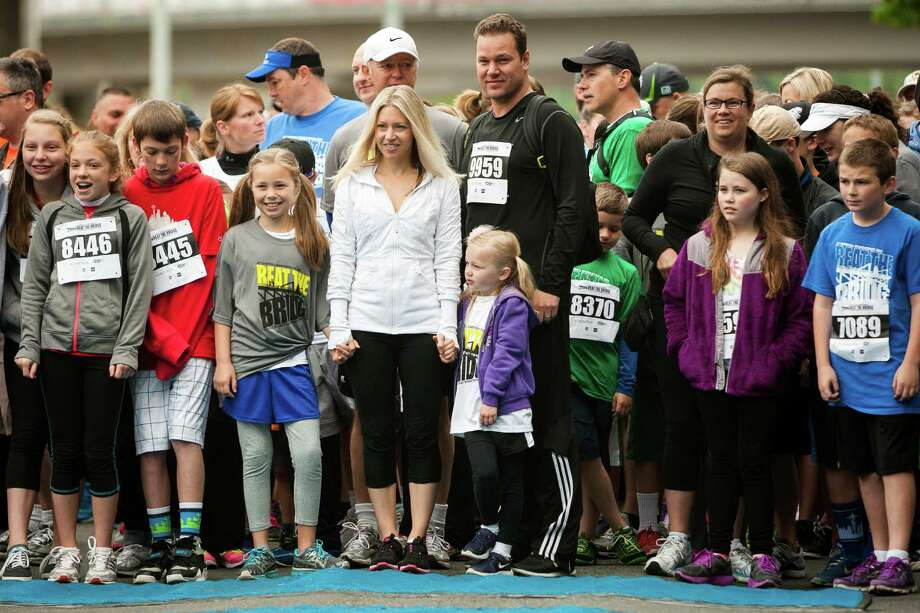 Nearly 11,000 attendees await the beginning of the 31st annual Nordstrom Beat the Bridge event outside of the Alaska Airlines Arena Sunday, May 19, 2013, in Seattle. The fundraiser for JDRF is the largest charitable supporter of type 1 diabetes research. The event consists of an 8K run and wheelchair race, a 4-mile walk, a 1-mile fun run and the Diaper Derby for toddlers. Photo: JORDAN STEAD, SEATTLEPI.COM / SEATTLEPI.COM