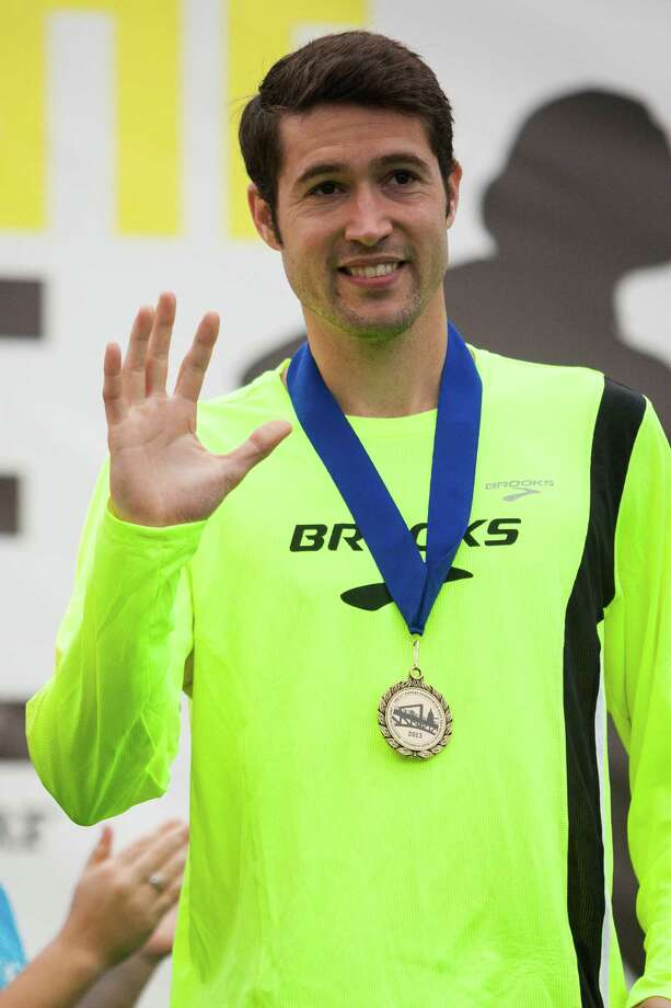 Jordan Horn, first place winner of the men's eight kilometer race, accepts his medal following the 31st annual Nordstrom Beat the Bridge event Sunday, May 19, 2013, in Seattle. The fundraiser for JDRF is the largest charitable supporter of type 1 diabetes research. The event consists of an 8K run and wheelchair race, a 4-mile walk, a 1-mile fun run and the Diaper Derby for toddlers. Photo: JORDAN STEAD, SEATTLEPI.COM / SEATTLEPI.COM
