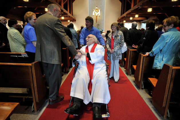 Father Robert Hyl greets parishoners immediately after Sunday mass at Church of the Holy Spirit in Stamford on May 19, 2013. Father Robert Hyl is celebrating his 50th year as a priest. Photo: Jason Rearick / Stamford Advocate