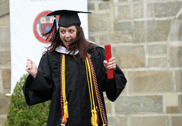 Madeline Goralski, of NY, reacts after receiving her diploma during Fairfield University's 63rd Commencement ceremony on the Fairfield, Conn. campus on Sunday, May 19, 2013. Photo: BK Angeletti, B.K. Angeletti / Connecticut Post freelance B.K. Angeletti