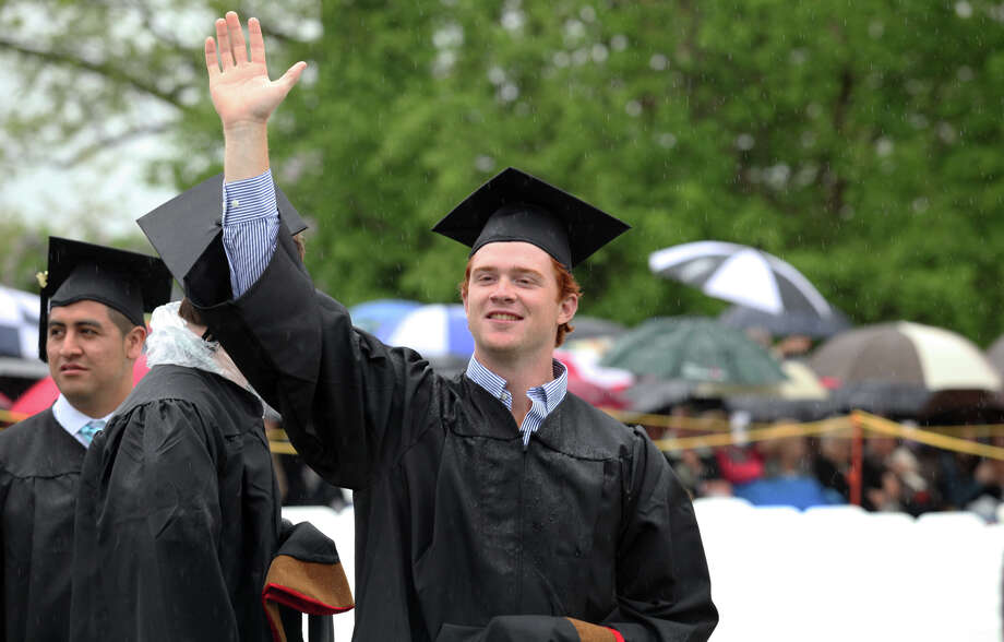 Brendan Carr, of PA, waves during Fairfield University's 63rd Commencement ceremony on the Fairfield, Conn. campus on Sunday, May 19, 2013. Photo: BK Angeletti, B.K. Angeletti / Connecticut Post freelance B.K. Angeletti